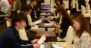Attendees take notes while talking to each other at a matchmaking party hosted in Tokyo. Japan's fertility rate is among the lowest in the world and its demographic dilemma grows more urgent year by year. Photograph: Akio Kon/Bloomberg