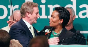 Sen Linda Dorcena Forry thanks Enda Kenny after the Taoiseach spoke at the annual St Patrick's Day breakfast in Boston. Photograph: AP Photo/Michael Dwyer