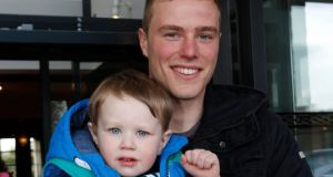 Little explorer Theo Costelloe (2) re-united with UL student James Ryan (21) who found him wandering along the road in the early hours of the morning. Photograph:  Liam Burke/Press 22