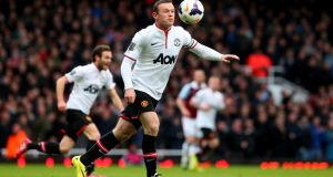 Manchester United's Wayne Rooney sizes up his shot from close to the halfway line in the Premier League game against West Ham at Upton Park. Photograph:  Julian Finney/Getty Images