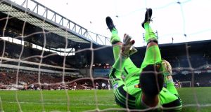 West Ham goalkeeper Adrian reacts after being beaten by the long range shot from Manchester United's Wayne Rooney  during the Premier League match at Upton Park. Photograph: Julian Finney/Getty Images