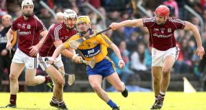Galway's Brian Flaherty, Daithí Burke and Iarla Tannian tackle Colm Galvin of Clare during the league clash at Ennis. Photo: James Crombie/Inpho