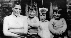Jean McConville (left) pictured with three of her children shortly before she disappeared in 1972. Photograph: Pacemaker