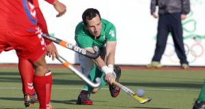 Peter Caruth in action in an  Ireland Olympic Games  qualifier against  Korea in 2012. Photograph: Donall Farmer/Inpho