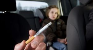 The Royal College of Physicians of Ireland is very keen to see the smoking ban extended to include smoking in cars where children are present. Photograph: Getty Images