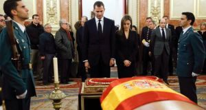 Spain's  Prince Felipe and Princess Letizia stand in front the coffin of former prime minister Adolfo Suárez during his wake at the Spanish parliament in Madrid yesterday. Photograph: Juanjo Martin/Reuters