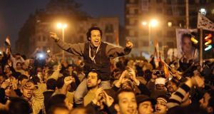 Egyptians celebrate on Tahrir Square in Cairo after the overthrow of president Hosni Mubarak in 2011. Those behind that revolution, however, say its goals have never been fulfilled. Photograph: Dylan Martinez/Reuters