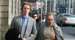 A file image of  Lucas Neville and his mother  Michelle Neville outside  the High Court in Dublin. The former St Michael's College student was today awarded €2.75 million damages for a  brain injury suffered during a rugby match. Photograph: Collins