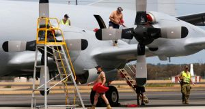 Personnel maintain a Royal Australian Air Force AP-3C Orion that has been used in the search for Malaysian Airlines flight MH370 over the Indian Ocean, at RAAF base Pearce near Perth today. Photograph: Reuters
