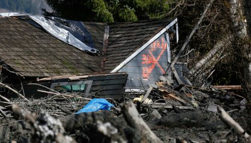 A devastated house is marked as having been searched. Photograph: Lindsey Wasson/Pool/Reuters