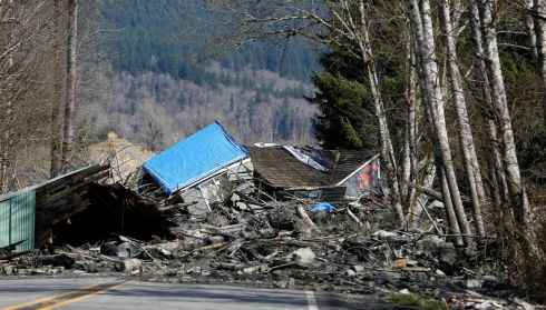 A massive trail of debris blocking Highway 530 near Oso. Photograph: Lindsey Wasson/New York Times