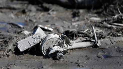 Mud encrusted debris. Photograph: Lindsey Wasson/Pool/Reuters