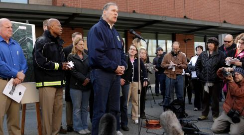 Governor Jay Inslee addresses the media outside the Arlington Police Department in Arlington, Washington as rescuers search for people still missing after the landslide. Photograph: Jason Redmond/Reuters