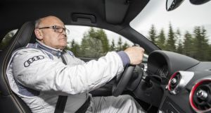 Behind the wheel: Stig Blomqvist in the S1
