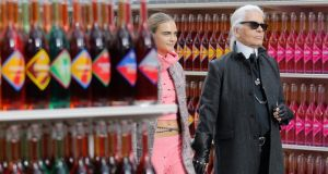 At Chanel, Karl Lagerfeld (above, with model Cara Delevingne) had the Grand Palais mocked up to look like a French hypermarket. Photograph: Stephane Mahe/Reuters