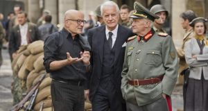 Director Volker Schlöndorff and actors André Dussolier (as Swedish consul Raoul Nordling) and Niels Arestrup (as Gen Dietrich von Choltitz) on the set of Diplomatie.