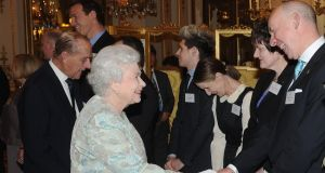 Fishmonger Pat O'Connell meets Queen Elizabeth at Buckingham Palace yesterday evening. Photograph: Malcolm McNally