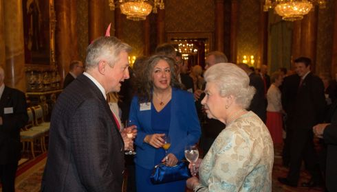 Louis Walsh speaks to Queen Elizabeth II at the Irish Community Reception last night. Photograph: Steve Parsons/WPA Pool/Getty Images