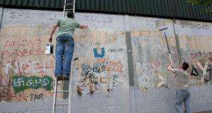 'If you are a teenager or in your 20s on the Falls or the Shankill  . . . you might react with something approaching rage when you are told again to settle down, don't cause trouble, don't undermine the peace.' Above, artists working on the Peace wall in West Belfast, in 2009. Photograph:  Paul Faith/PA Wire