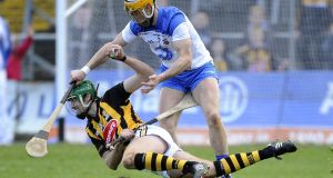 Kilkenny's Mark Kelly battles with Shane Fives of Waterford at Nowlan Park last Sunday. Photo: Tommy Grealy/Inpho