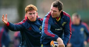 Peter O'Mahony and Sean Dougall durung a Munster squad training session at Mardyke Arena, UCC, Cork. Photograph: Inpho