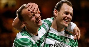 Celtic's Leigh Griffiths (left) and Anthony Stokes during the 5-1 win over Partick Thistle at Firhill Stadium. Photograph: Russell Cheyne/Reuters