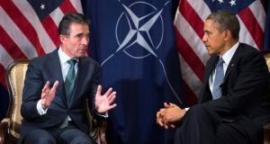 President Barack Obama meets Nato secretary general Anders Fogh Rasmussen in Brussels on Wednesday. Photograph: Doug Mills/ The New York Times