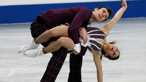 Canadian Eric Radford gives his back a free-skating workout as compatriot Meagan Duhamel weighs in. The Canadian pair won the bronze medal.  Photograph: Kimimasa Mayama/EPA