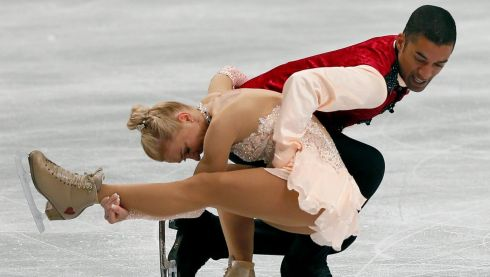 Sculptured flesh: Aliona Savchenko (left) and Robin Szolkowy of Germany perform their pairs free skating to win the gold medal. Photograph: Kimimasa Mayama/EPA
