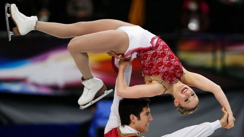 High on happiness: Canada's Paige Lawrence is held aloft by Rudi Swiegers. Photograph: Yuya Shino/Reuters