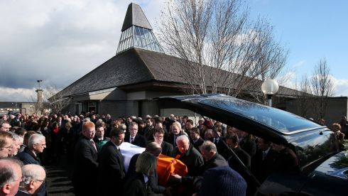 Members of the Fine Gael parliamentary party and mourners form a guard of honour as the coffin of Fine Gael TD Nicky McFadden is carried from the Our Lady Queen of Peace Church, Coosan, Athlone. Photograph: Brian Lawless/PA Wire