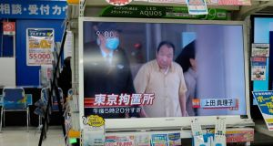A television on display at an electronics store in Tokyo shows footage of Iwao Hakamada, who has spent over 45 years in solitary confinement on death row, being released from prison. Photograph: Franck Robichon/EPA