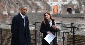President Obama is accompanied by the technical director of the Colosseum, Barbara Nazzaro as he is given a tour yesterday. Photograph: Ettore Ferrari/EPA