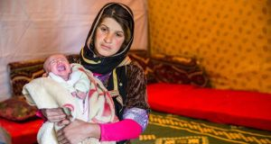 Refugees: a young Syrian mother with her month-old daughter, who was born in Lebanon. Photograph: Naoise Culhane