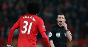 Manchester United's Marouane Fellaini speaks to referee Michael Oliver during the Manchester derby. Photograph: Peter Byrne/PA Wire.