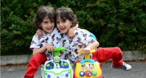 Twins: Hassan and Hussein Benhaffaf last August. Photograph: Bryan O'Brien
