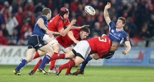 Munster's BJ Botha tackles Brian O'Driscoll of Leinster. Photo: Billy Stickland/Inpho