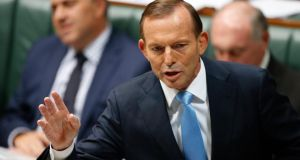 "Australia's prime minister, Tony Abbott, backed a comment by attorney general George Brandis that people have ""a right to be bigots"". Photograph: Daniel Munoz/ EPA"
