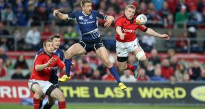 Luke Fitzgerald of Leinster and Munster's Keith Earls engage in aerial combat during the RaboDirect Pro12 game at Thomond Park in March 2012. Photograph: Dan Sheridan/Inpho