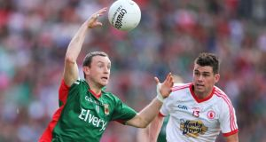 Mayo's Keith Higgins in action against Tyrone's Darren McCurry. The versatile Higgins could be the answer to Mayo's lack of firepower up front as they prepare for another championship year.
