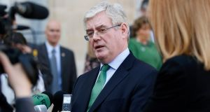 Tánaiste and Minister for Foreign Affairs Eamon Gilmore talks to the media after his meeting with French president Francois Hollande at the Elysee Palace in Paris earlier this month. Photograph: EPA/Yoan Valat