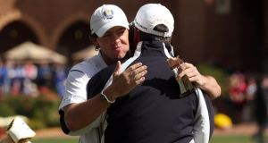 Rory McIlroy of Europe hugs his captain Jose Maria Olazabal on the putting green after arriving late to the golf course during the singles matches for The 39th Ryder Cup at Medinah Country Club on September 30th, 2012 in Medinah, Illinois. Photograph: Ross Kinnaird/Getty Images