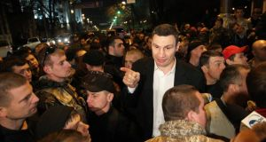 Ukrainian Democratic Alliance for Reform (UDAR) party leader Vitaly Klitschko (C) addresses activists of the Right Sector movement. He has said he will not run for the presidency. Photograph: Valentyn Ogirenko/Reuters.