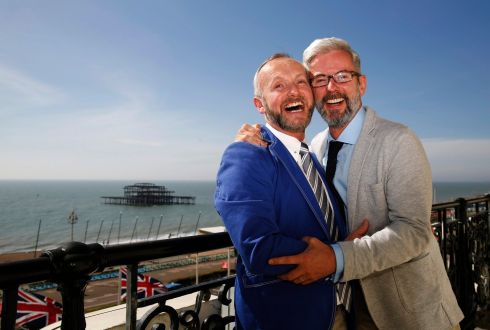 Gay couple Andrew Wale (R) and Neil Allard laugh as they pose in their hotel after marrying in the first same-sex wedding in Brighton, which took place at the Royal Pavilion, in southern England March 29th, 2014.  Photograph: Luke MacGregor /Reuters
