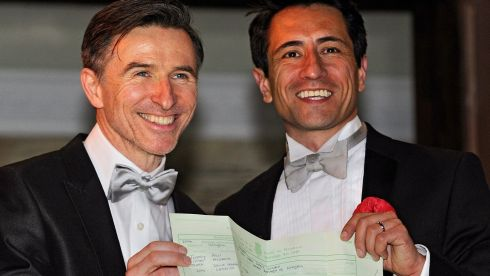 Peter McGraith (L) and David Cabreza, who have been partners for 17 years, show their marriage certificate after getting married outside Islington Town Hall in London. Photograph: Facundo Arrizabalaga/EPA