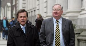 A fiel photograph of Minister for Communications Pat Rabbitte (right) and Minister for Justice Alan Shatter. Photograph: Alan Betson/The Irish Times.