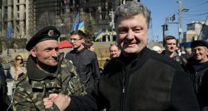Petro Poroshenko greets people in Kiev's Independence Square yesterday. Photograph: Reuters/Maks Levin