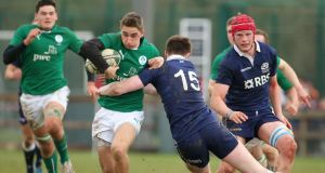 Under 18 Schools International, Coolmine RFC, Co Dublin: Ireland's Jack Power is tackled by Scotland's Ruairi Howarth. Photograph:  Kieran Murray/Inpho
