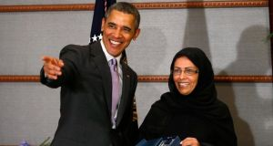 US president Barack Obama presents the executive director of Saudi Arabia's national family safety programme, Maha Al Muneef, with the US secretary of state's international woman of courage award in Riyadh. Photograph: Reuters/Kevin Lamarque