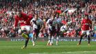 United's Wayne Rooney  scores his side's second  from the  penalty spot. Photograph: Alex Livesey/Getty Images